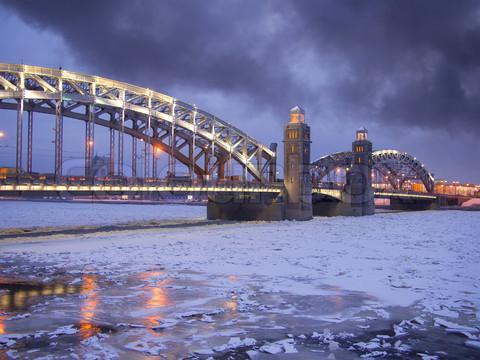 Bolsheokhtinsky Bridge in St. Petersburg in the winter evening.