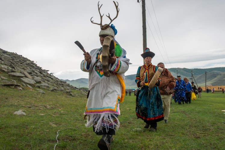 Shamans beat their drums in opening rituals at the rainy first day of Yordinski games.