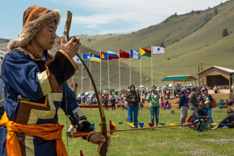 Archery, wrestling and horse racing are the three major sporting events of the Buryat. Here a young archer finds his focus.