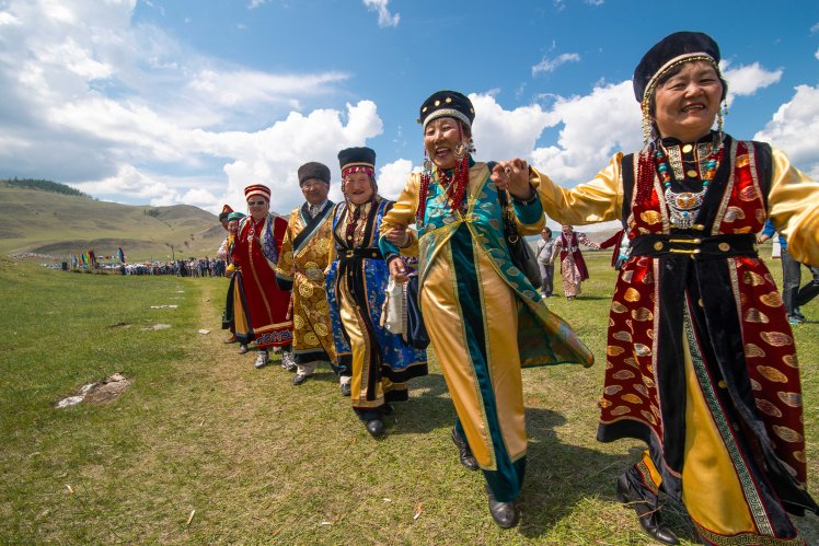 These happy Western Buryats, friends, circle a sacred hill at the Yordinski Games in Central Siberia.