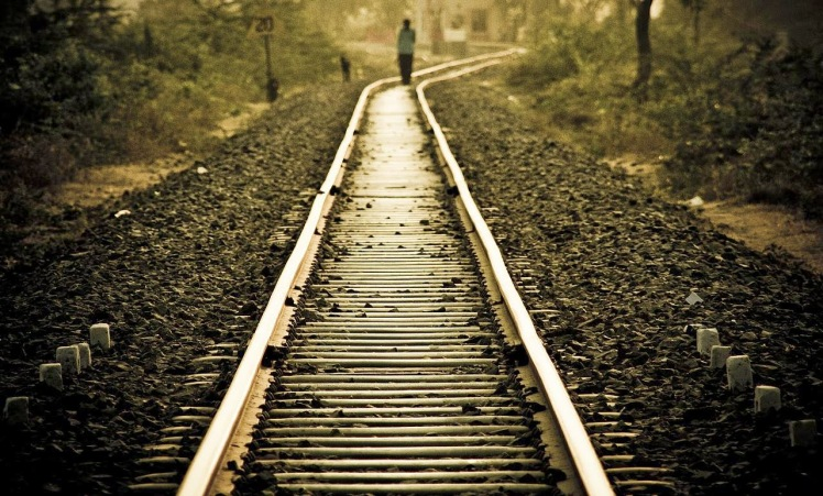 lonely_girl_walking_on_railway_track