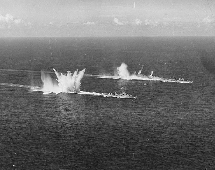 USS Epperson (DDE-719), center, and USS Sarsfield (DD-837), at right. Dropping depth charges during anti-submarine warfare exercises